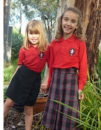 Girls' Uniform Options. In summer, girls may wear either black skorts (shown here) or black shorts with a short sleeved red polo shirt. In the winter, girls may also choose to wear a winter skirt with a red polo top.