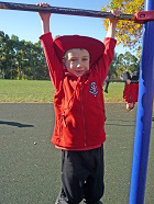 Boys' Uniform Options. In winter boys can wear long black pants with the long-sleeved red polo shirt. Between the months of September and May, children are expected to wear head protection such as this sunsmart broad-brimmed hat. Boys and girls can also choose to wear a red polar fleece vest (shown here) or long sleeved red polar fleece jacket.